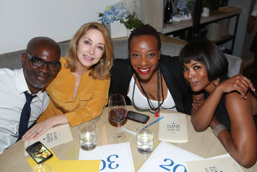 Evan Williams, Sharon Lawrence, Marianne Jean-Baptiste, and Angela Bassett pose for a photo at LA Chefs for Human Rights at Cassia in Santa Monica, Calif. on Monday, Oct. 10, 2016.